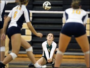 Central Catholic's Kaitlin Bronikowski (5) returns a a serve against  Notre Dame on Tuesday, during the Division I volleyball district semifinals in Perrysburg.