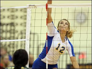St. Ursula's Madison Strall (12) spikes the ball against   Clay Tuesday.