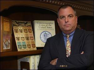 Tom Noe with just a few books in his Vintage Coins and Collectibles office library in March, 2005.