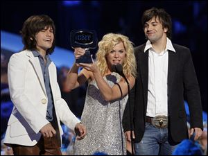 From left to right, Reid, Kimberly and Neil Perry from The Band Perry are in the running for best vocal group at the Country Music Awards on Nov. 9 on ABC.