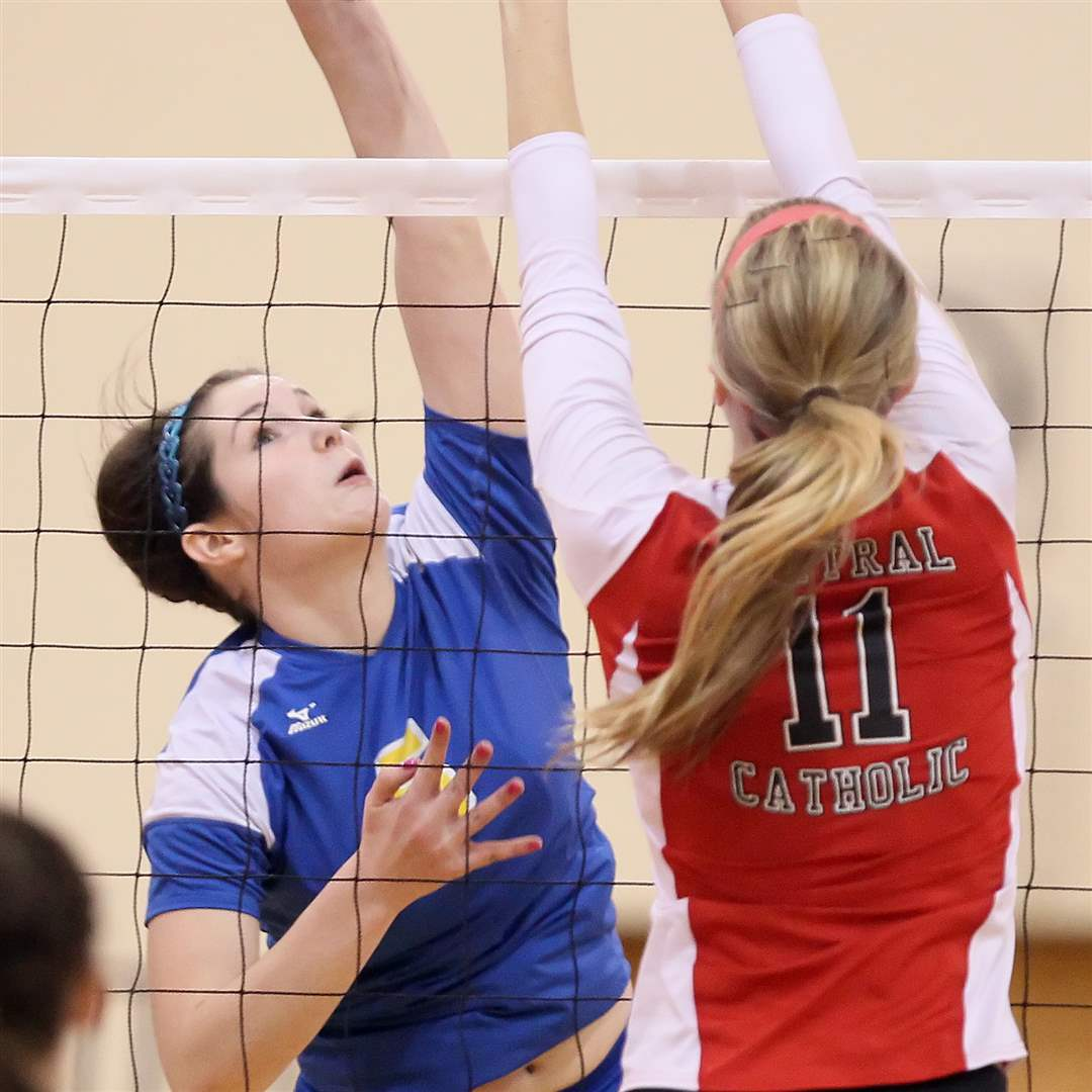 St-Ursula-s-Katie-McKernan-reaches-for-a-spike-with-Central-Catholic-s-Abby-Wietrzkowski-defending