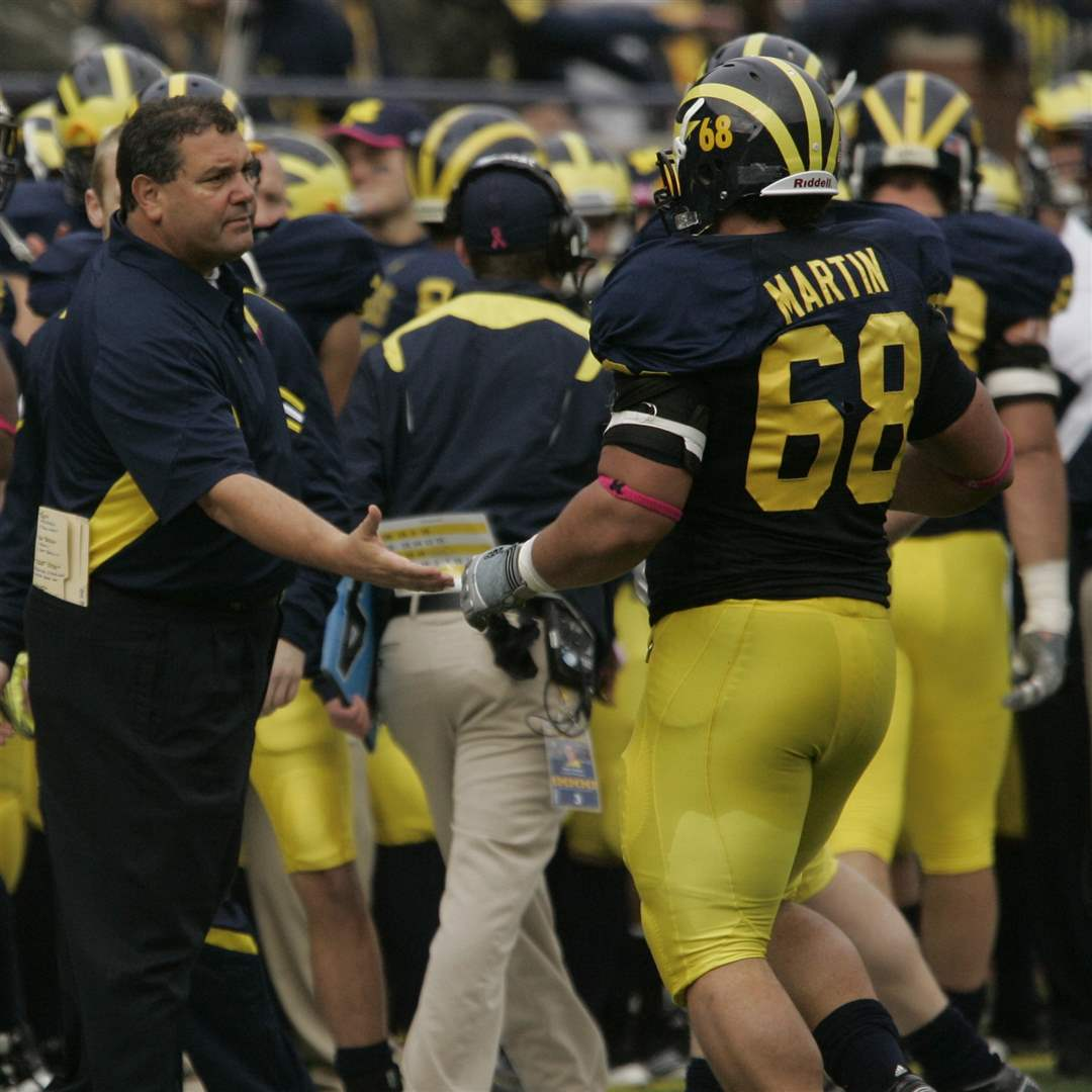 UM-s-Brady-Hoke-shakes-shakes-hands-with-Mike-Martin-after-he-forced-a-Purdue-safety