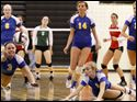 St. Ursula's Madison Haupricht (3) and Maurissa Leonard (1) dive for the ball against Central Catholic Saturday.
