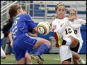 Sylvania Northview's Erin Bishop (15) takes a shot at the goal as  Anthony Wayne's Hayley Wagner (22) defends Saturday.