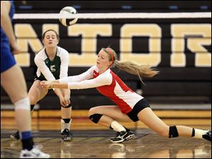 Central Catholic's Abby Wietrzykowski (11) and Kaitlin Bronikowski (5) defend against St. Ursula Saturday.
