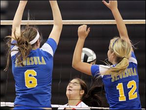 St. Ursula's Cassidy Croci (6) and Madison Strall (12) shut down a spike from Central Catholic's Mikenzie Tschantz (2) Saturday.