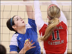St. Ursula's Katie McKernan (5) spikes the ball against Central Catholic's Abby Wietrzykowski (11) Saturday.