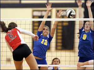 St. Ursula's Madison Strall (12) and Lauran Graves (8) defend against Central Catholic's Jennifer Kowalski (6) Saturday.