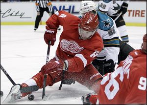 Detroit Red Wings left wing Justin Abdelkader (8) and San Jose Sharks center Michal Handzus (26), of Slovakia, battle for the puck during the second period of an NHL hockey game in Detroit, Friday.