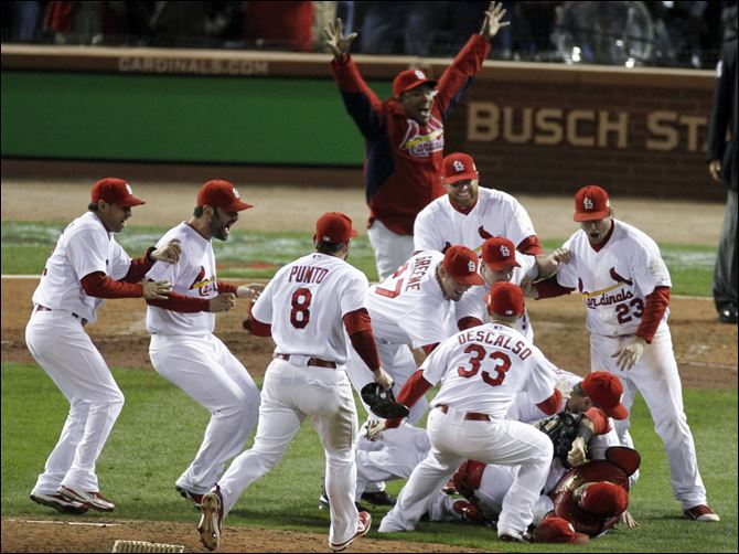World Series champion St. Louis Cardinals 1029 St. Louis Cardinals react after beating the Texas Rangers 6-2 at Game 7 of baseball's World Series Friday, in St. Louis. The Cardinals win the series 4-3.