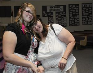 Kelsey Ball, 16, left, and her mom, Colleen Ball, reflect after speaking at an event sponsored by the Toledo Area Alliance to End Homelessness at Friendship Baptist Church in South Toledo. It was the first time Kelsey spoke publicly about her experiences being homeless.