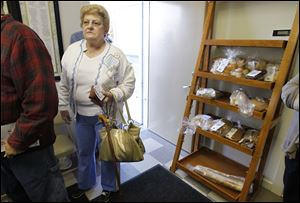 Kathleen Kress of Perrysburg, jobless since 2008, waits for food at Perrysburg's Grace United Methodist Church.