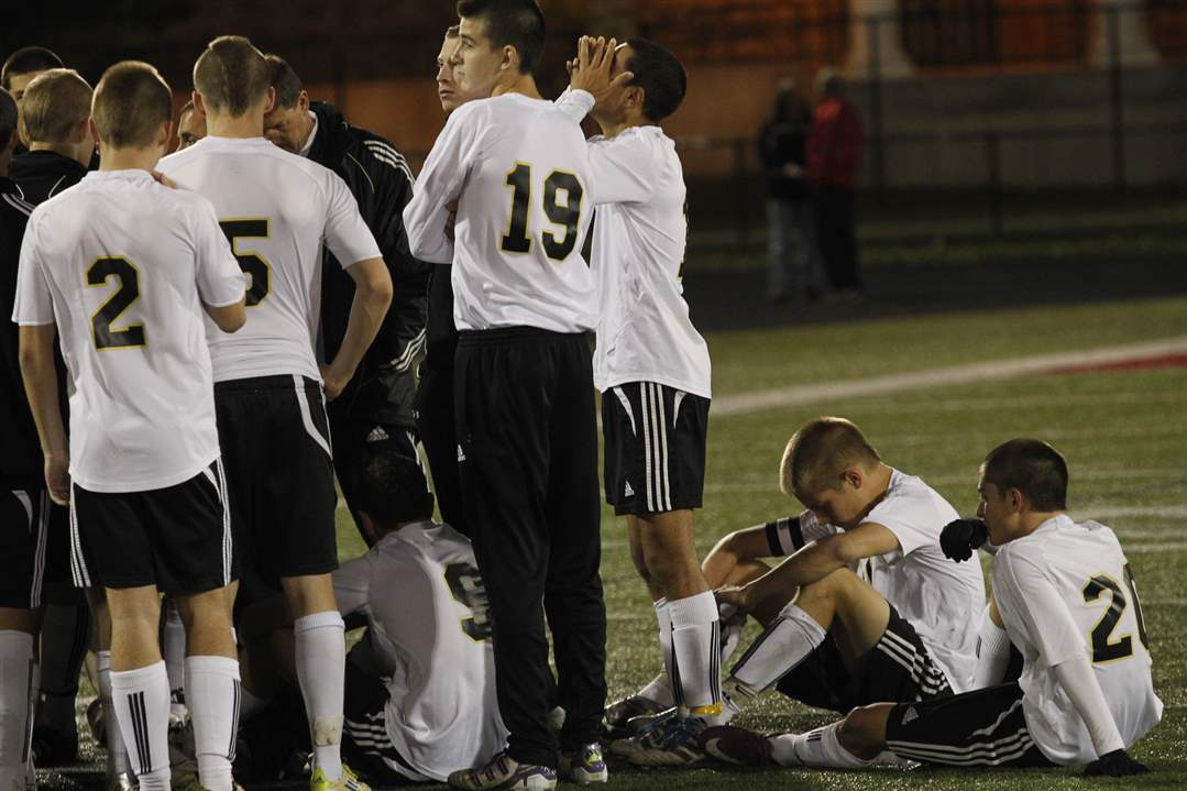 Perrysburg-team-reacts-to-a-loss-to-St-John-s