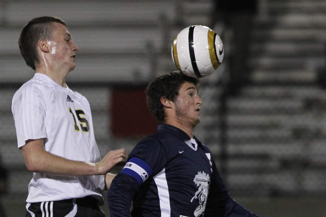 Perrysburg-s-Josh-Kemp-watches-as-St-John-s-heads-a-ball