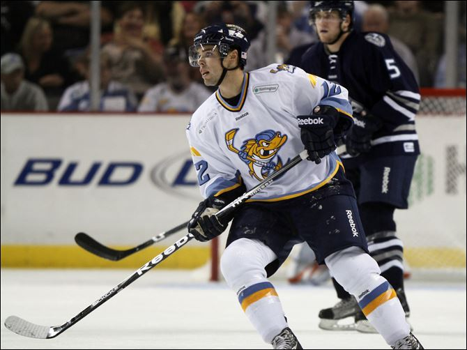 Wall to wall with aaron lewicki Toledo Walleye player Aaron Lewicki, 12, skates against the Chicago Express in an ECHL opener at Huntington Center, Saturday.