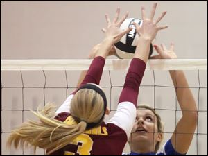 St. Ursula's Madison Strall (12) blocks Avon Lake's Lauren Bakaitis (3) Wednesday during a Division I volleyball regional semifinal at Norwalk High School.