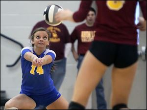 St. Ursula's Katie Felix (14) returns a serve against Avon Lake Wednesday during a Division I volleyball regional semifinal at Norwalk High School.