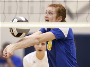 St. Ursula's Lauran Graves (8) returns a serve against Avon Lake Wednesday during a Division I volleyball regional semifinal at Norwalk High School.