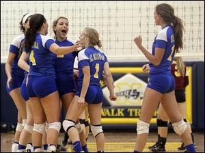 St. Ursula celebrates defeating Avon Lake Wednesday in a Division I volleyball regional semifinal at Norwalk High School.