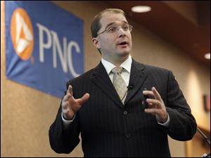 Kurt Rankin, an assistant vice president and economist for The PNC Financial Services Group, speaks to invited guests at the PNC Bank's annual luncheon at the Pinnacle in Maumee.