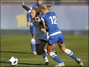 Toledo's Nicole Gyurgyik, left, battles past Buffalo's Natalie Jurisevic during a MAC women's soccer, semifinal game at Scott Park, Friday, November 4, 2011.