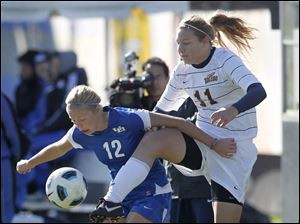 Buffalo's Natalie Jurisevic, 12, left, battles for the ball with Toledo's Nicole Gyurgyik, 11.