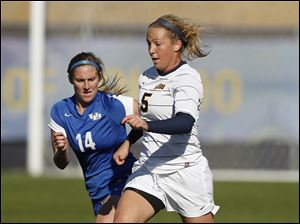 Toledo's Rachael Kravitz, 5, moves past Buffalo's Katie Kerr, 14.
