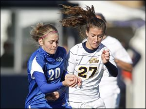 Buffalo's Danielle Turner, left battles for the ball with Toledo's Rachel MacLeod.