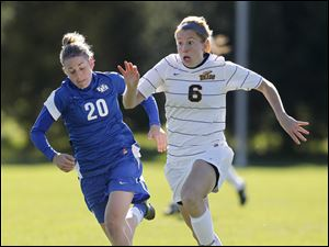 Toledo's Kristen Lynn, 6, moves the ball past Buffalo's Danielle Turner, 20.