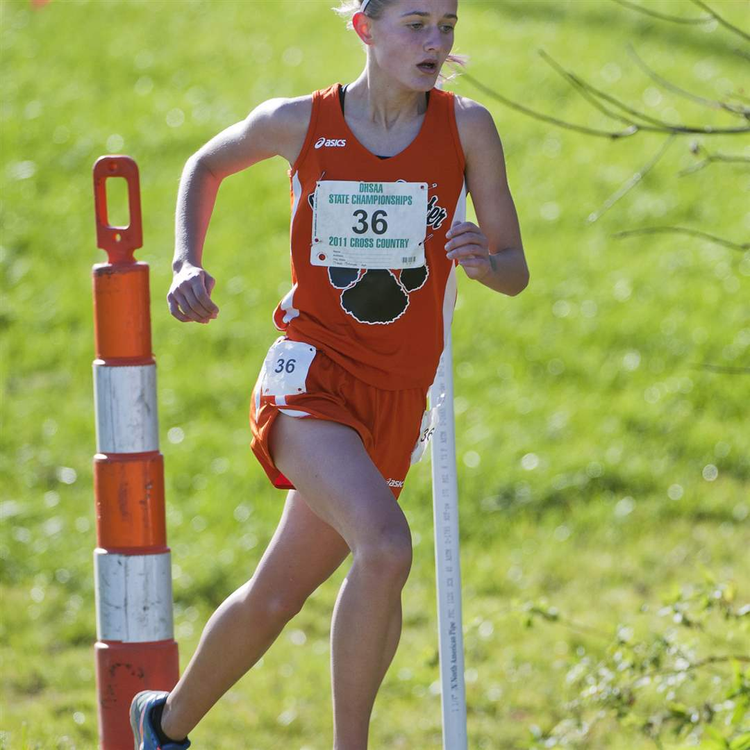 Liberty-Center-s-Brittany-Atkinson-races-past-a-flag-near-the-2-mile-mark