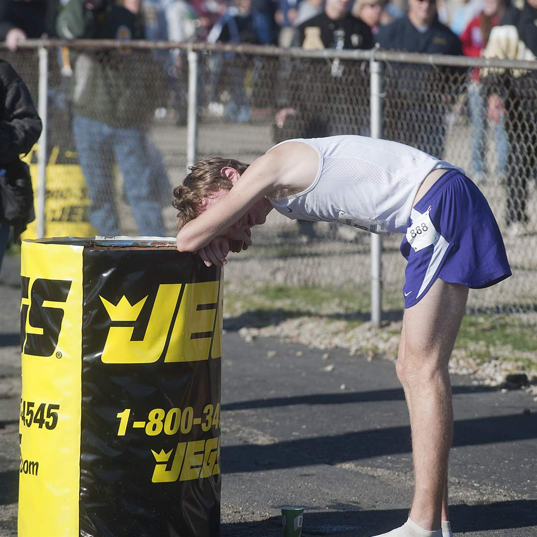 Maumee-runner-Willy-Fink-rests-after-finishing-third