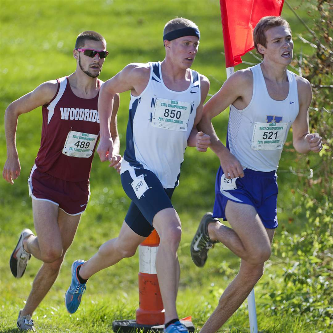 Napoleon-s-Steve-Weaver-middle-fights-for-position-in-the-Boy-s-DII-State-Cross-Country-Meet