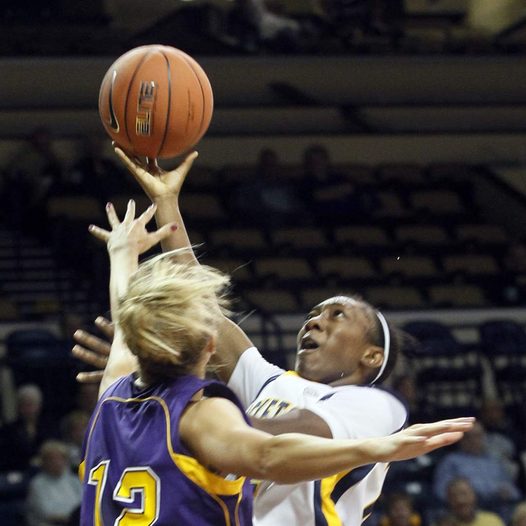 UT-s-Andola-Dortch-gets-a-shot-up-over-Ashland-s-Alyssa-Miller