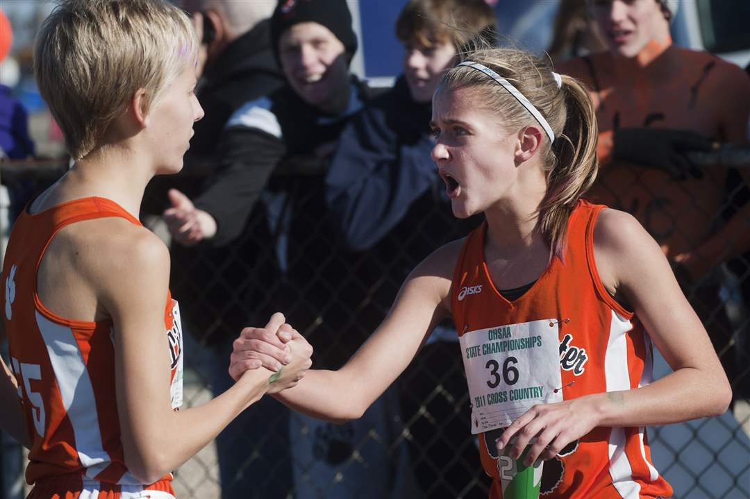 Liberty-Center-runner-Brittany-Atkinson-congratulates-teammate-Kelly-Haubert