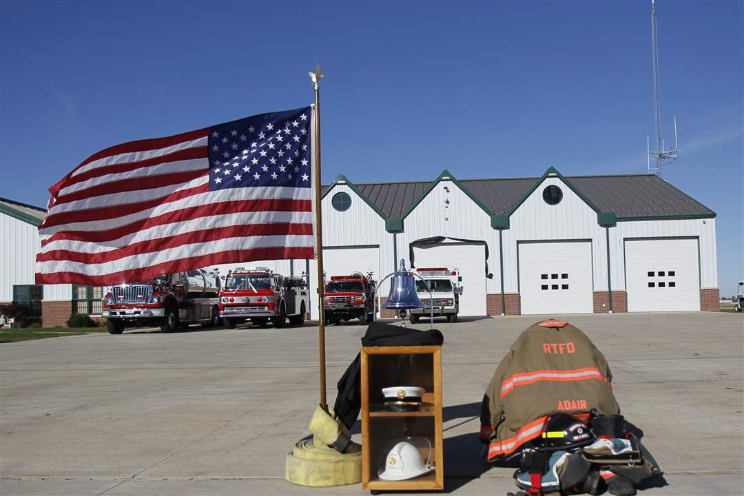 Flag-and-firefighters-gear-outside-fire-station