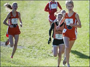 Liberty Center runners Kelly Haubert (38) and Paige Chamberlain (37) run near the two-mile post at the Girl's Div. III State High School Cross Country Championships in Hebron.