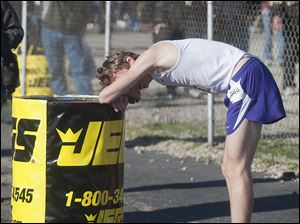 Maumee High School runner Willy Fink needs a rest after finishing third in the Boy's Div. I State High School Cross Co