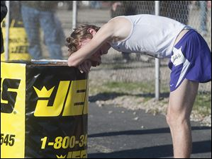 Maumee High School runner Willy Fink needs a rest after finishing third in the Boy's Div. I State High School Cross Country Championship in Hebron.