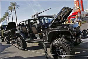 The 2011 'Call of Duty: Black Ops' Jeep Wrangler Unlimited was modified by a Texas company. Among the accouterments are a 5.7-liter Hemi V8 engine and machine-gun mounts on the roof and sides.
