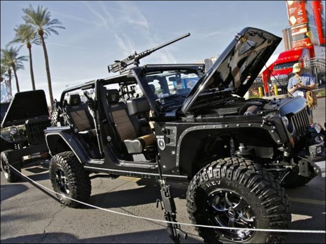 Call of Duty Black Ops Jeep Wrangler Unlimited The 2011 'Call of Duty: Black Ops' Jeep Wrangler Unlimited was modified by a Texas company. Among the accouterments are a 5.7-liter Hemi V8 engine and machine-gun mounts on the roof and sides.