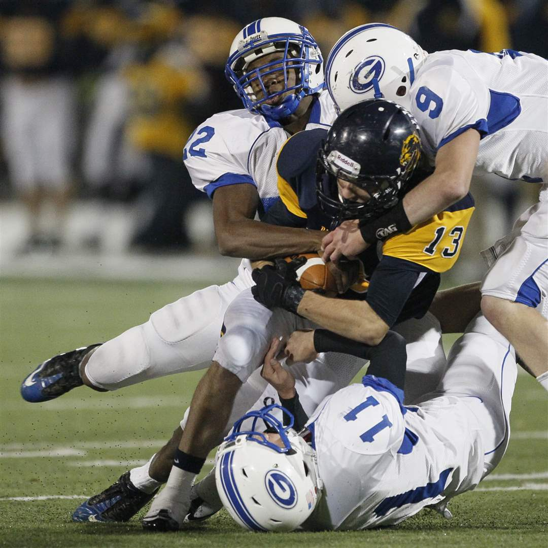 Whitmer-s-Verroco-13-is-tackled-by-AW-s-Omofoma-Chipka-and-Schwerer