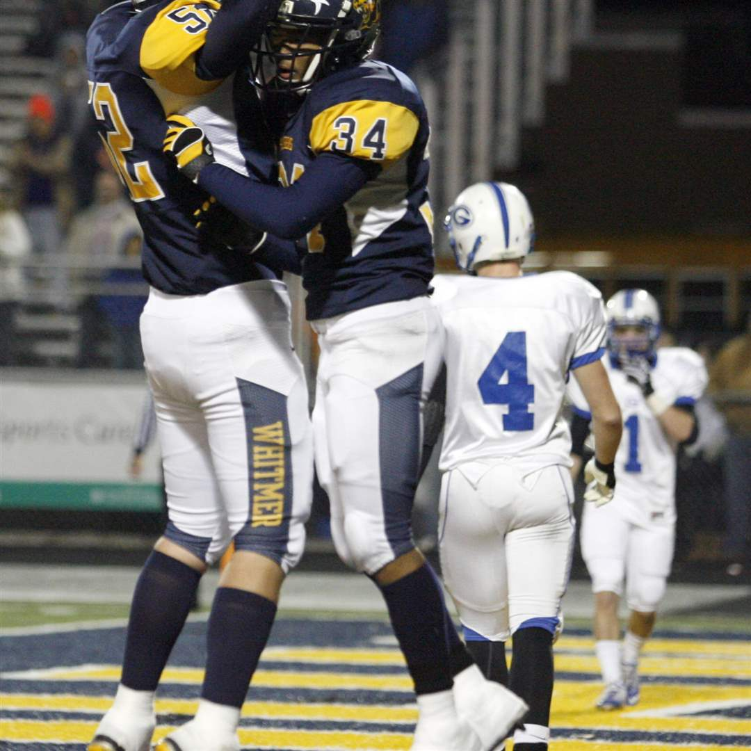 Whitmer-s-Wert-52-and-Webb-34-celebrate-a-TD