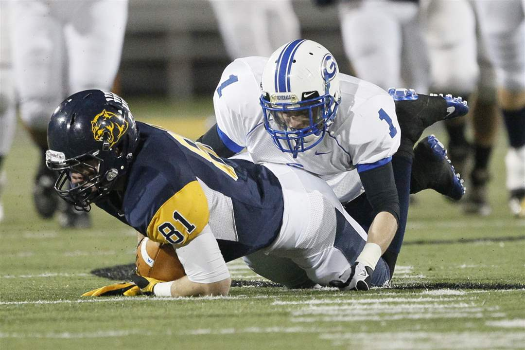 Whitmer-s-Longenbarger-81-is-tackled-by-AW-s-Granger
