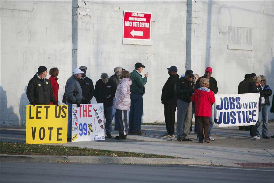 About-25-people-showed-up-to-rally-outside-the-Early-voting-Center
