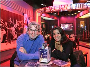 Kelly Leonard, left, vice-president at the Second City comedy club and Liz Garibay with the Chicago History Museum, sit within a display highlighting Chicago's Jazz and Blues history at the museum in Chicago. Second City, famed for its parody and improvisation, has partnered with the museum to turns its wit on Chicago itself.