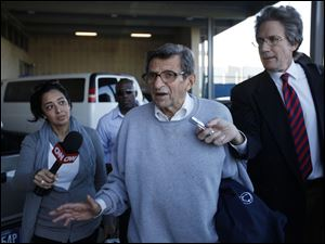 associated pressPenn State football coach Joe Paterno leaves a campus building. A poll Tuesday found mixed support for him.
