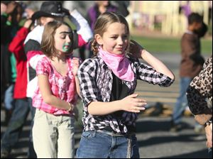 Grace Barcum, 9, and Elizabeth Lunsford, 9 dance the Macarena during Harvest Day at Wayne Trail School.