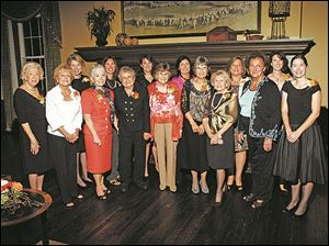 Past and present leaders of the Toledo Hospital Auxiliary gather at the 90th anniversary celebration at Inverness Club.