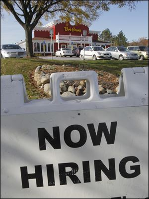 associated pressSigns such as this outside a Bob Evans in Solon, Ohio, a Cleveland suburb, have become more prevalent.