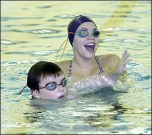 Stingray swimmers Brendan Varnes, left, and Meegan Smith share a laugh in between laps during practice.